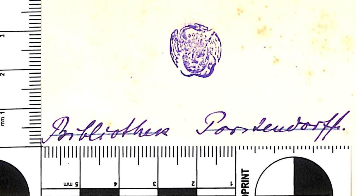 """Stempel (Drachen mit Wappenschild) und handschriftlicher Eintrag """"Bibliothek Porstendorff"""""""