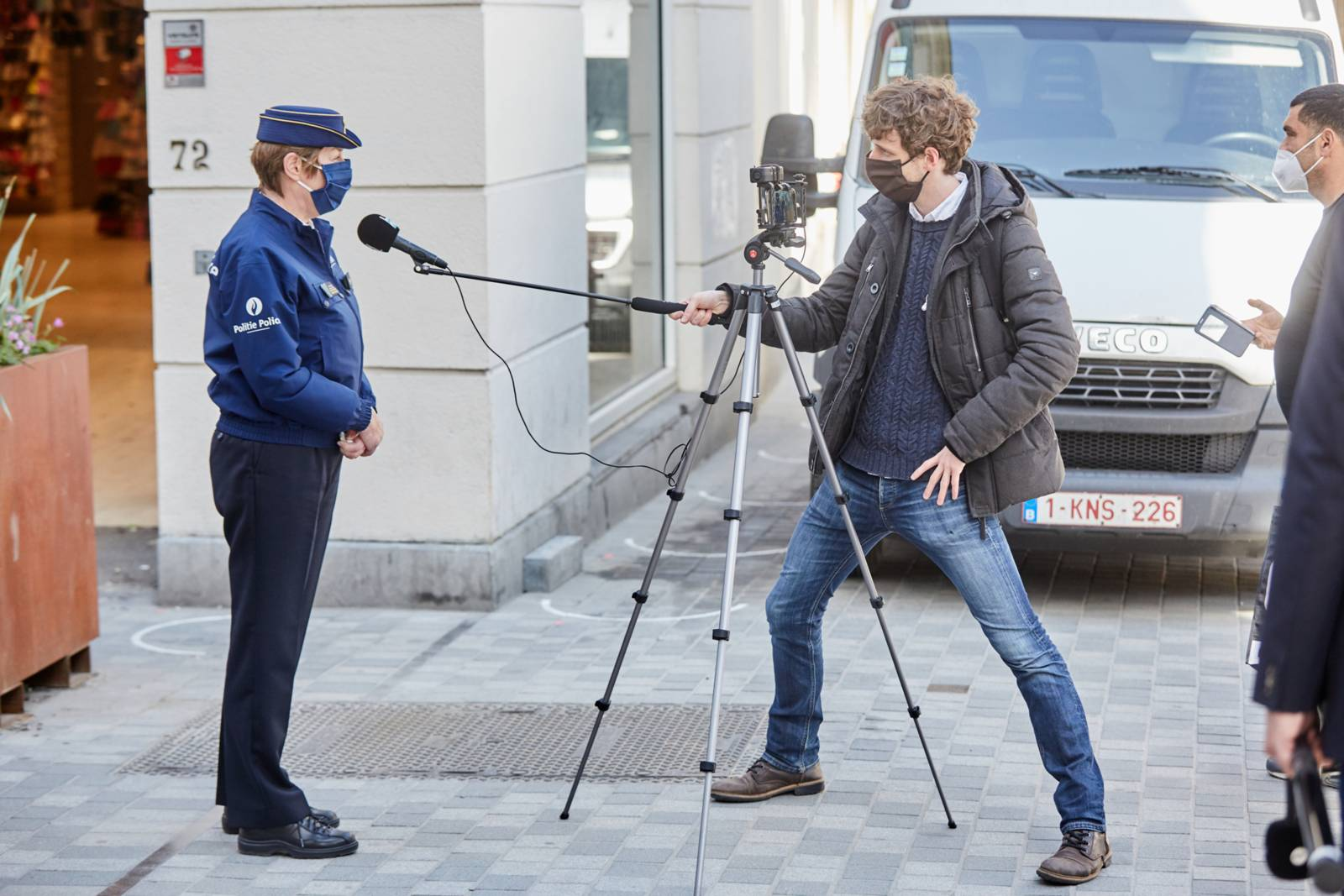 A police officer being interviewed by a journalist