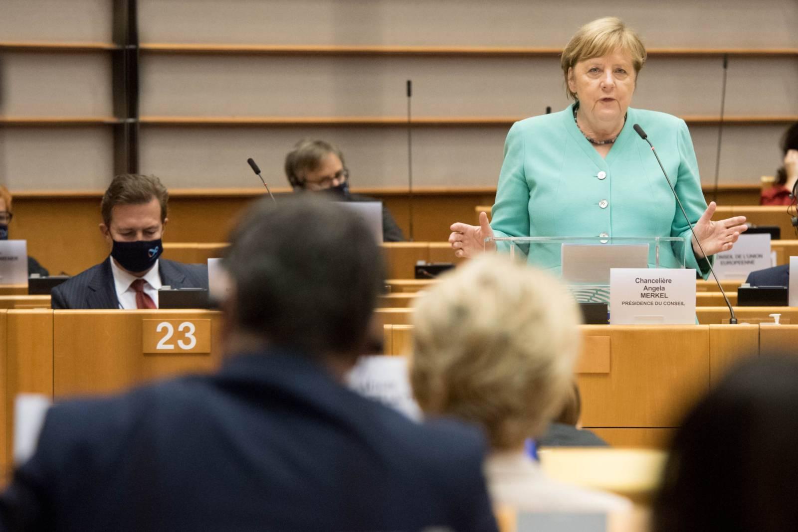 Ursula von der Leyen, (from behind), and Angela Merkel