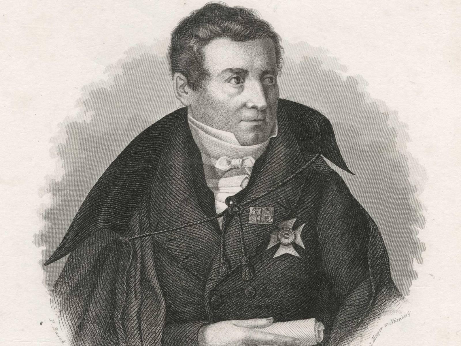 Porträt von August Wilhelm Schlegel, der eine Auszeichnung am Revers trägt und in der rechten Hand eine Papierrolle hält