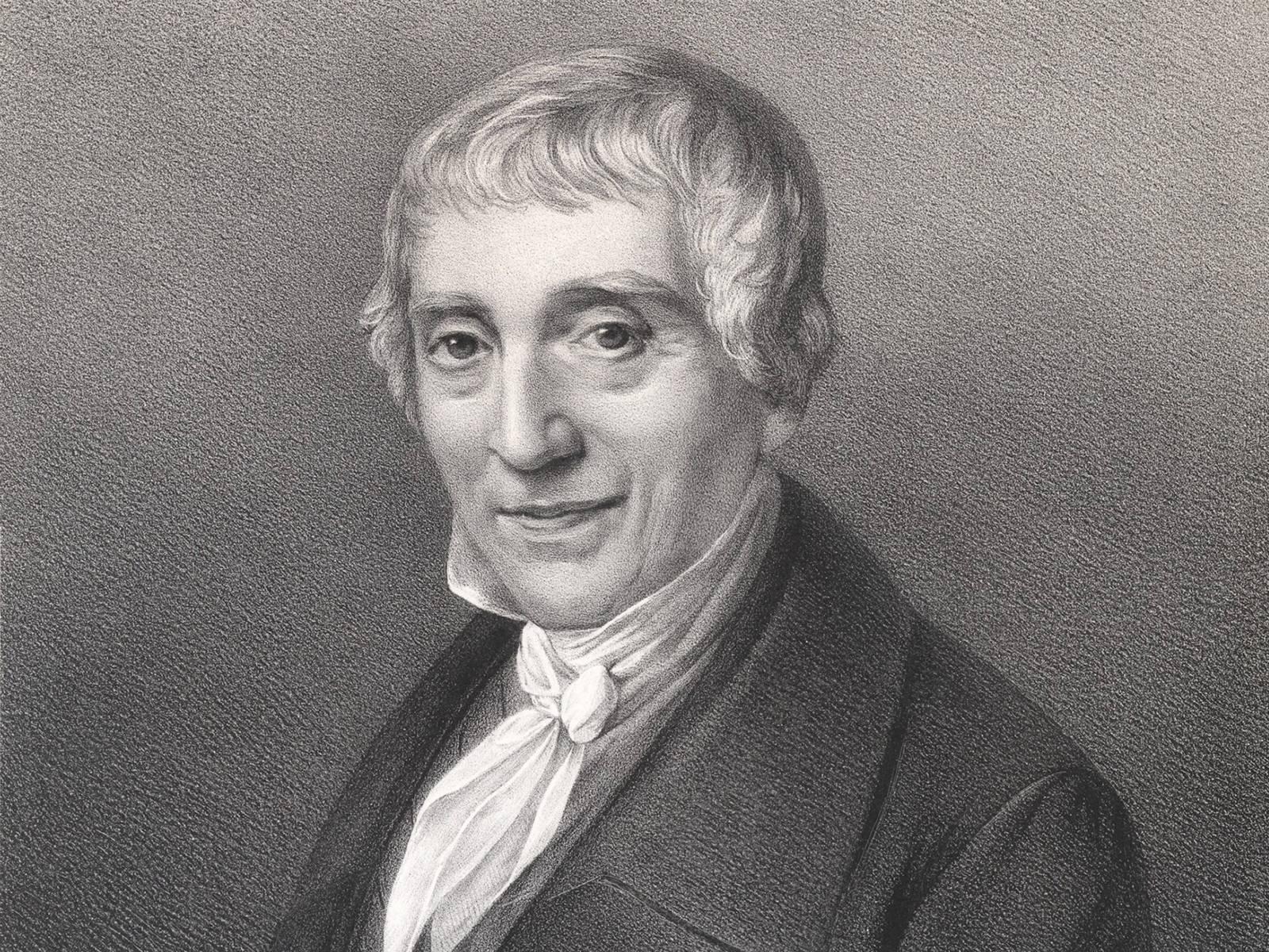 Die Lithografie zeigt das Brustbild Grotefends von links mit nach vorn gewandtem Gesicht.