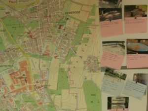Fotos neben einem Stadtteilplan dokumentieren, was Kinder bei der Fotorallye in Bemerode entdeckt haben.