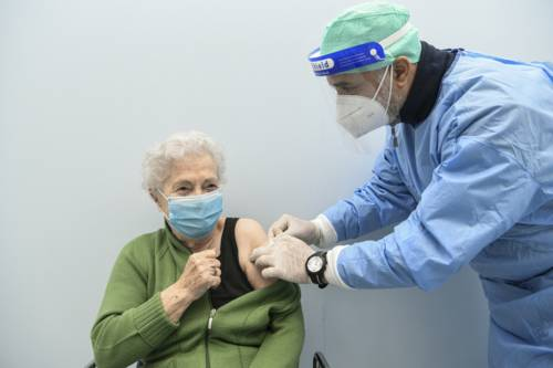 A military doctor administering influenza vaccine to a patient