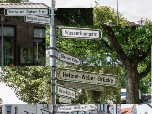 Auf dem Bild sind mehrere Straßenschilder zu sehen.