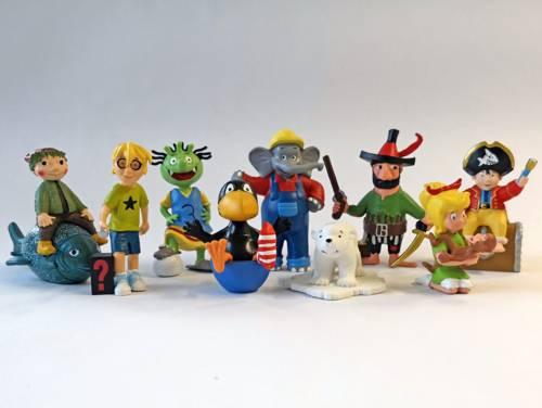 Verschiedene Tonie-Figuren, darunter Benjamin Blümchen, Bibi Blocksberg und der kleine Rabe Socke.