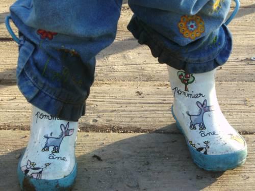 Beine in Gummistiefeln