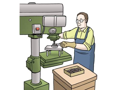 Ein Mann arbeitet an einer Maschine.
