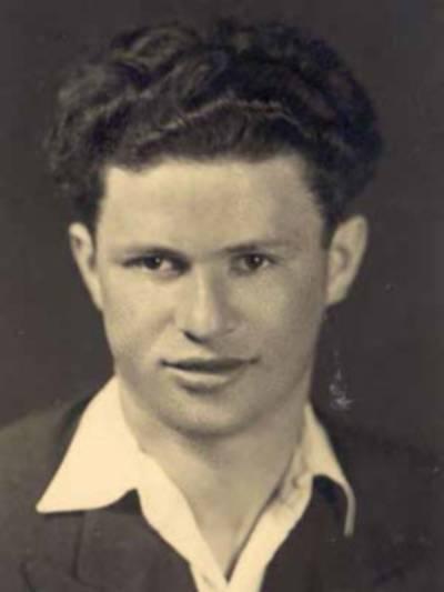 Alte Portraitaufnahme (schwarz-weiß) eines jungen Mannes.