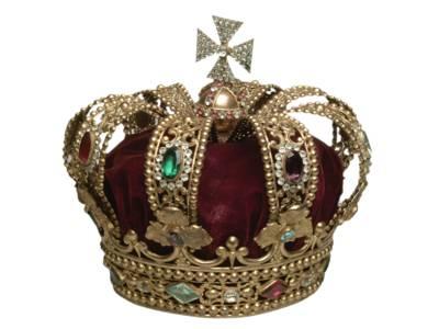 Totenkrone Georgs V.  Nachbildung der hannoverschen Königskrone, benutzt zum Schmücken des Sarges Königs Georg V. bei der Aufbahrung in Paris und der Beisetzung in Windsor. Aus Messing, vergoldet, mit Steinen aus buntem Glas, das Innere aus rotem Samt. Höhe 20cm