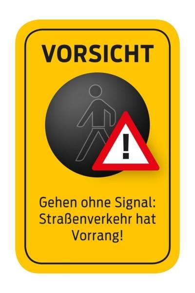 """Ein Piktogramm mit folgendem Text: """"Vorsicht - Gehen ohne Signal: Straßenverkehr hat Vorrang!"""""""