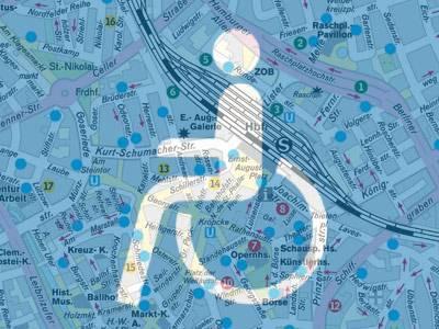 Piktogramm eines Rollstuhlfahrers vor Stadtkarte