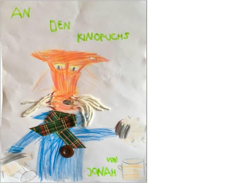Jonah hat den Kinofuchs gemalt und gebastelt mit Schnurrhaaren aus Wolle, einem Schal und einem Knopf