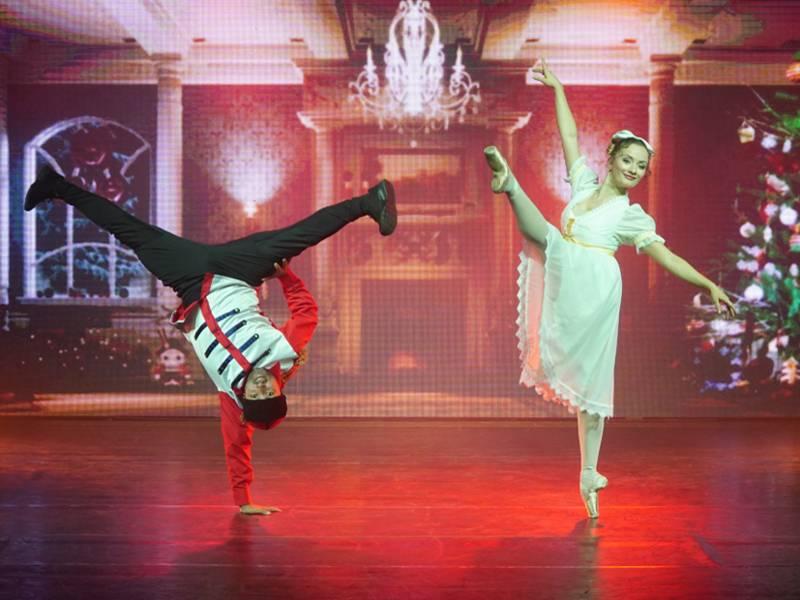 Mann in Breakdance-Pose, Frau in Ballettpose