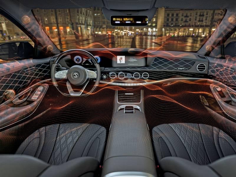 Grafik eines Autoinneren mit gezeichneten Schwingungslinien