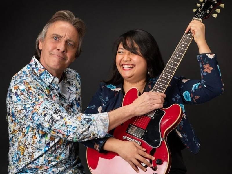 Mann und Frau mit Gitarre