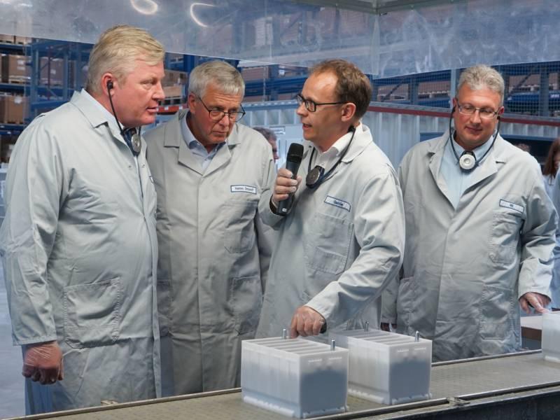 Vier Männer in Kitteln