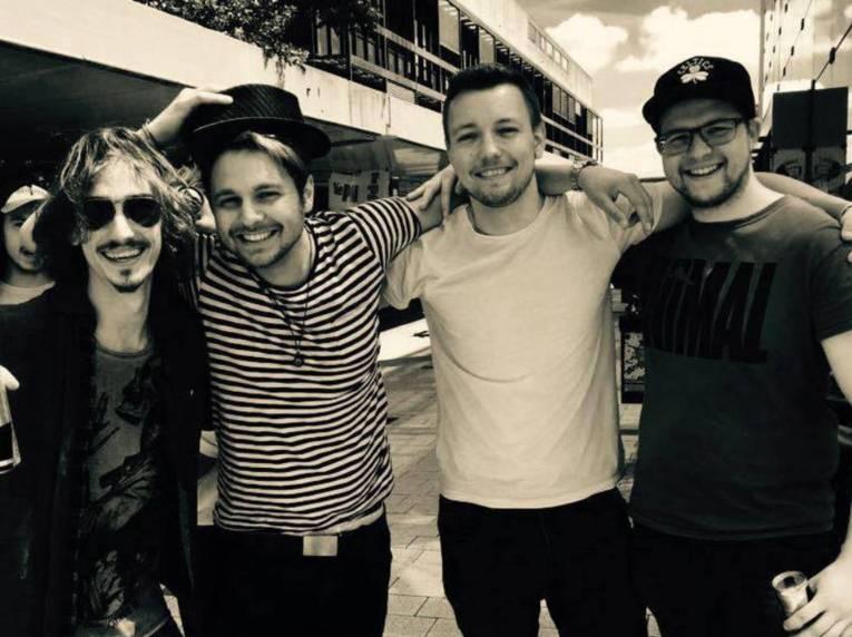 Vier junge Männer.