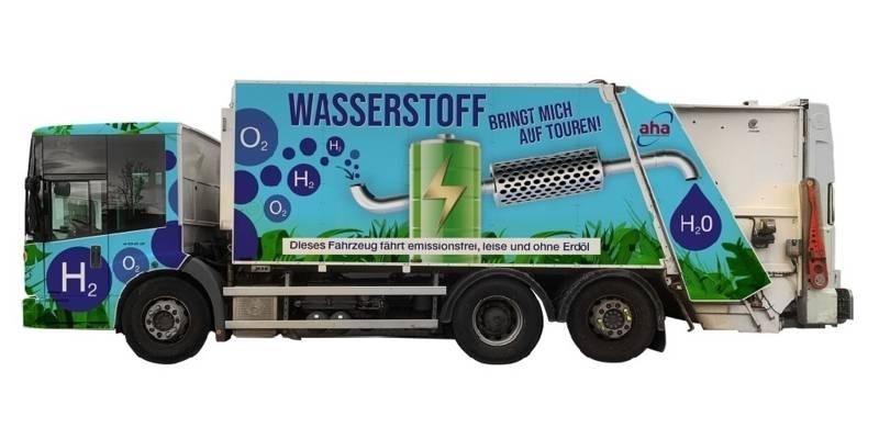 """Müllwagen mit der Aufschrift """"Wasserstoff bringt mich auf Tour"""""""