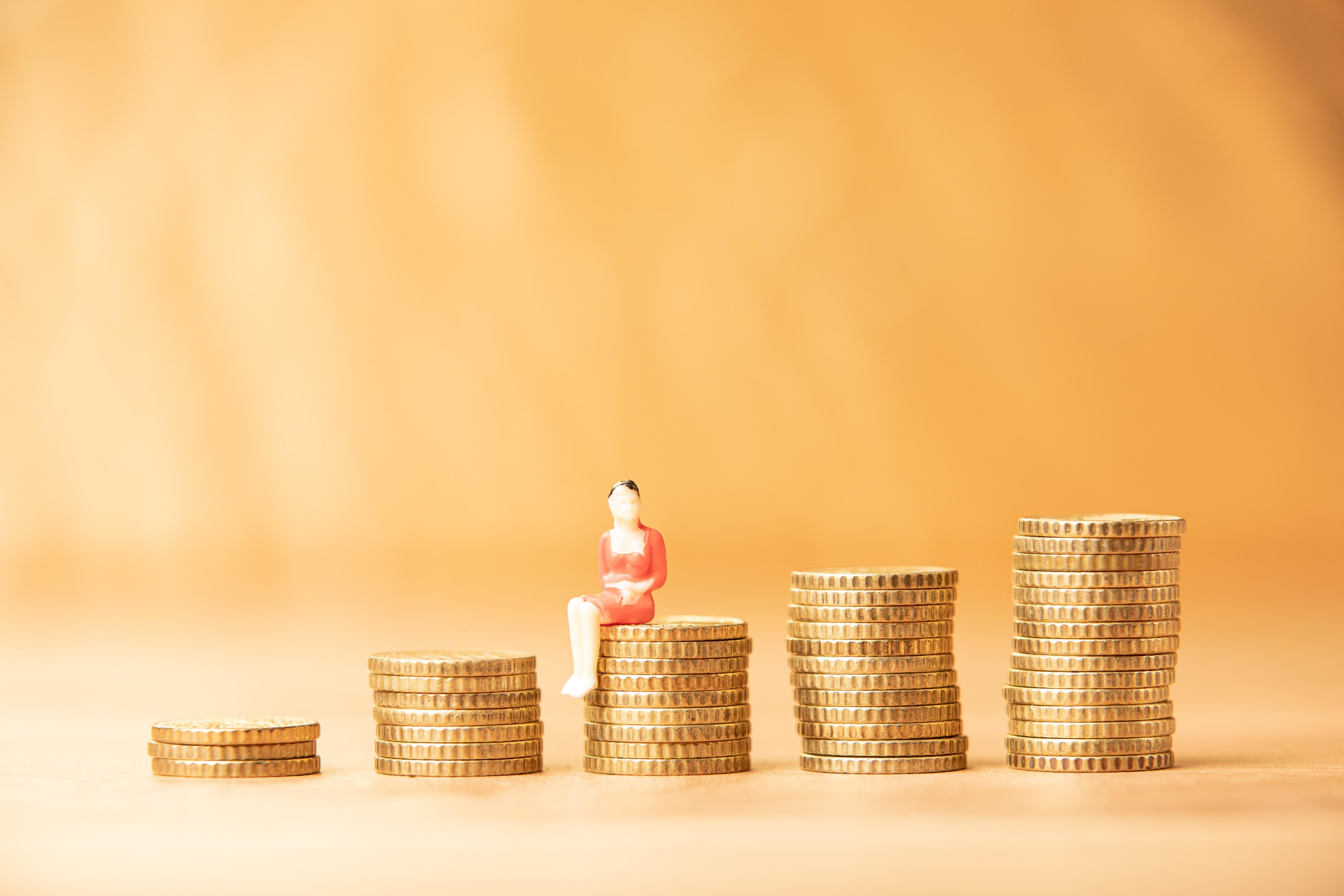 Coins and miniature figurine