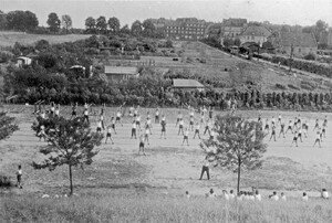 """Exercises at the 1939 sports festival"". A view from the girls' building over the sport grounds towards Harenberger Strasse (today Heisterbergallee)"