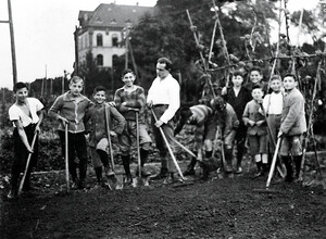 Pupils and teachers in the school garden near the girls' building in the 1920s.