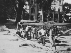 Participants in a vocational re-training course in 1933 digging for the construction of sporting grounds next to the girls' building