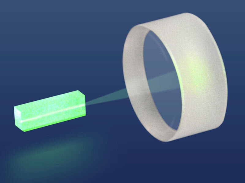 A green rectangular object is directing a laser beam into a mirror.