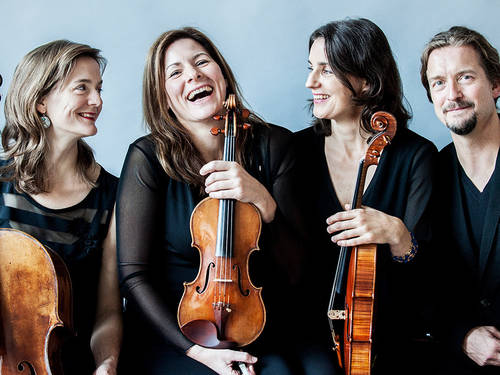 Three women and a man with violins